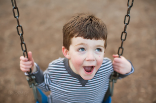 portrait of a happy child on a swing